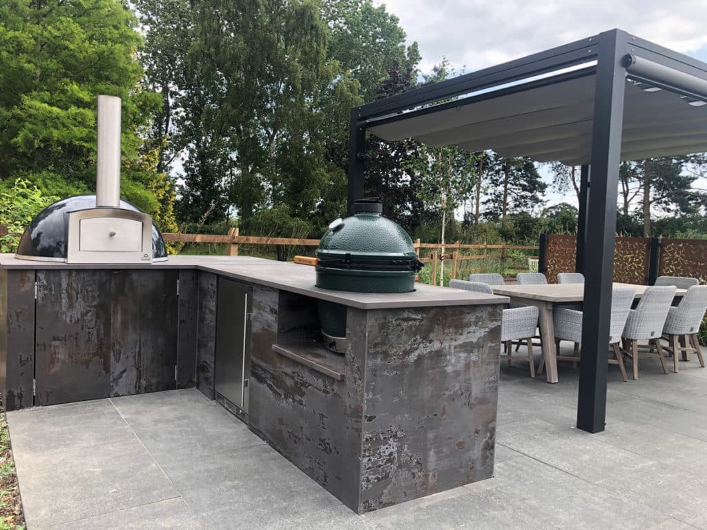 outdoor kitchen with pizza oven and smoker