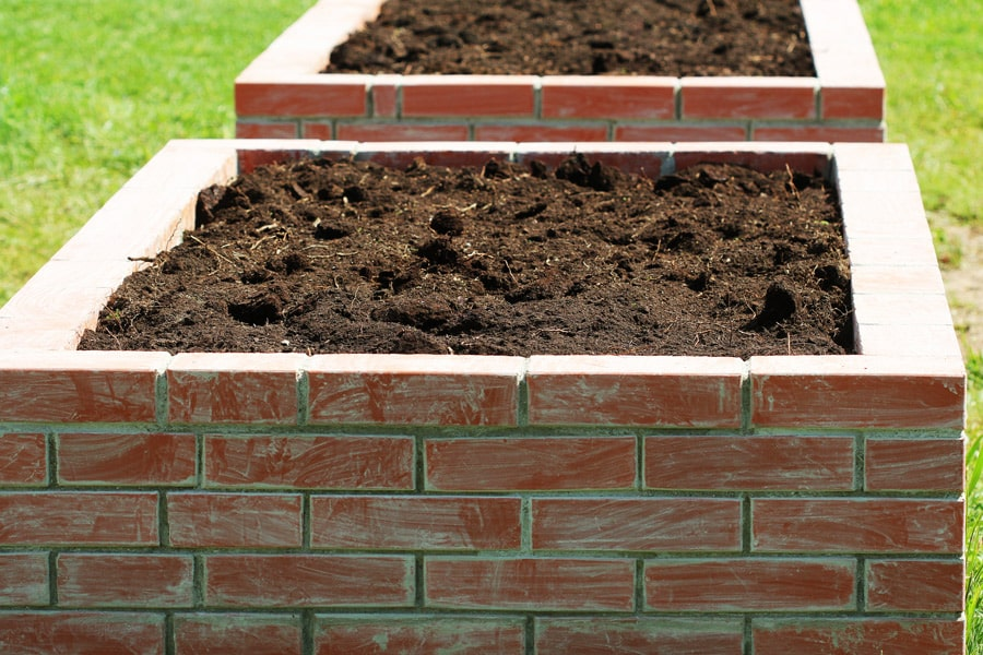 raised vegetable beds made with bricks