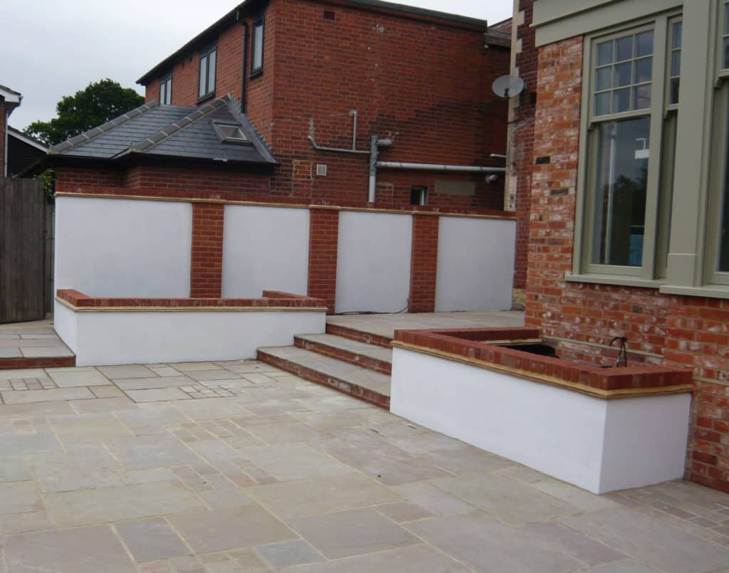 raised beds with patio and steps