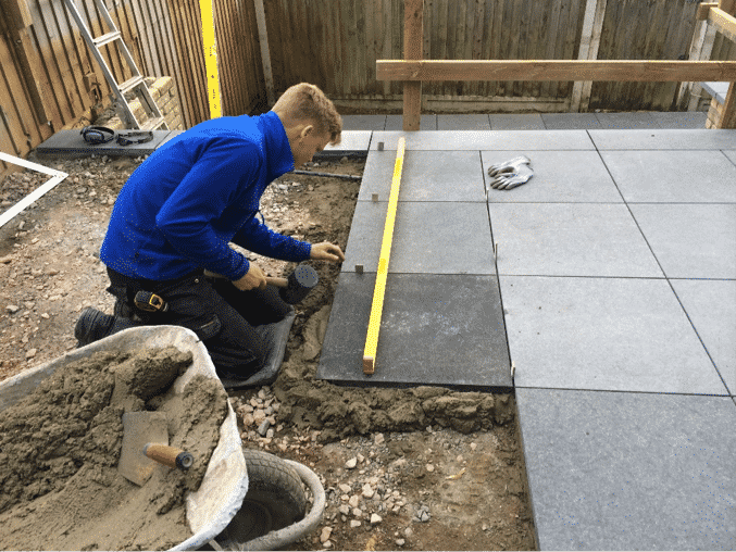 laying limestone slabs to make a patio
