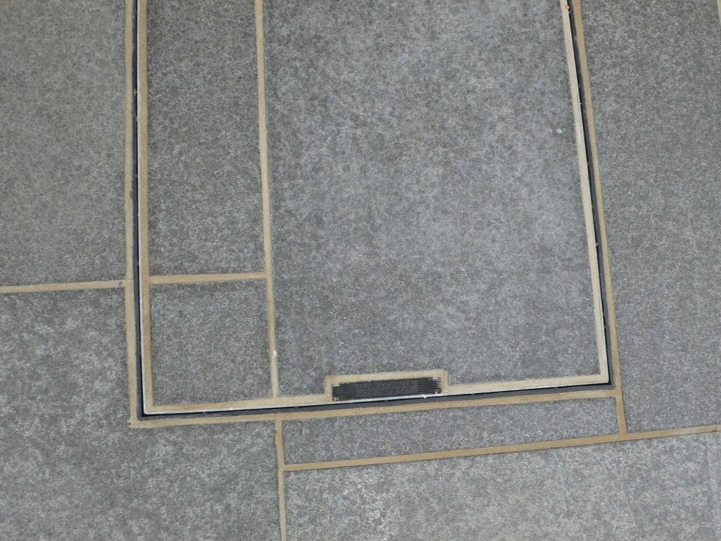 patio slabs cut into manhole