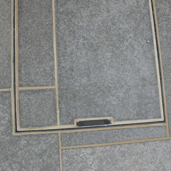 patio slabs cut into manhole