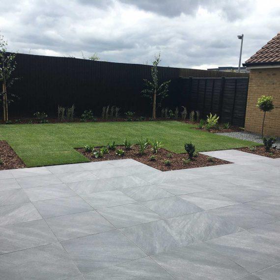 mid grey porcelain patio in modern garden