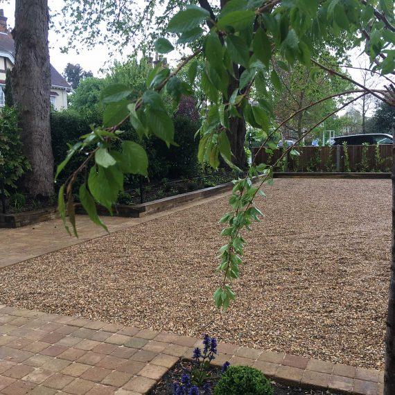 gravel drive with block paving edges and paths