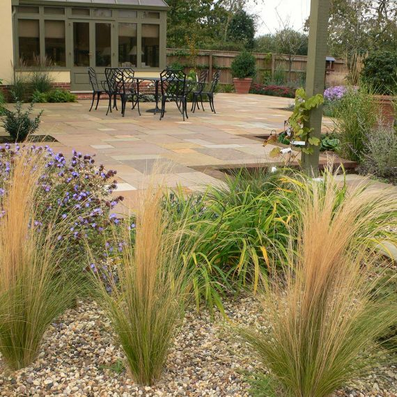 bronze grasses in a gravel border