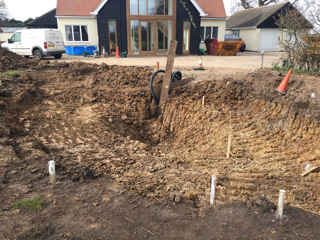 pond construction in clay soil