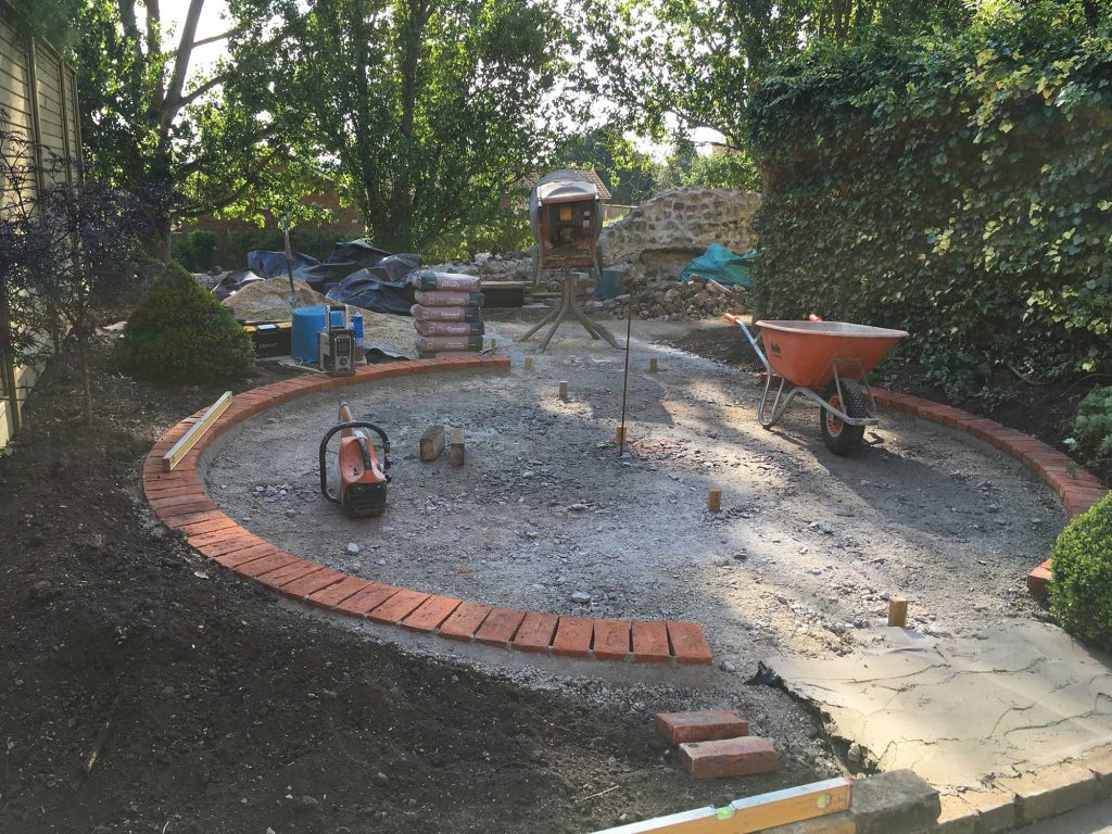creating a circular brick weave patio area