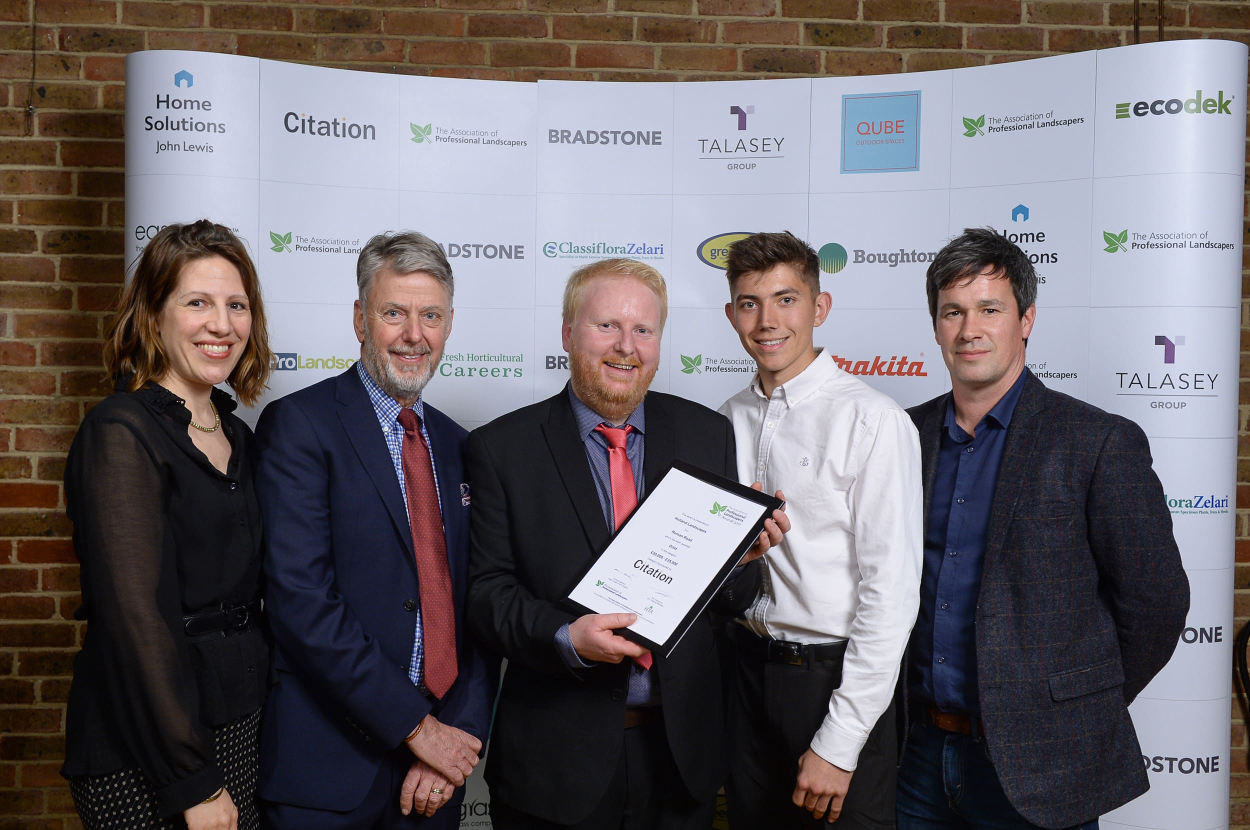 Holland Landscapes Team with one of their APL Awards 2019