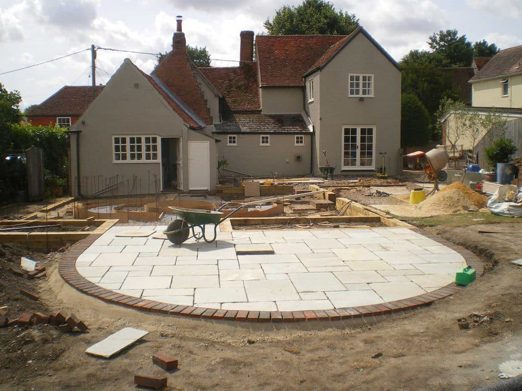 making a curved edge patio in a large garden in Tiptree