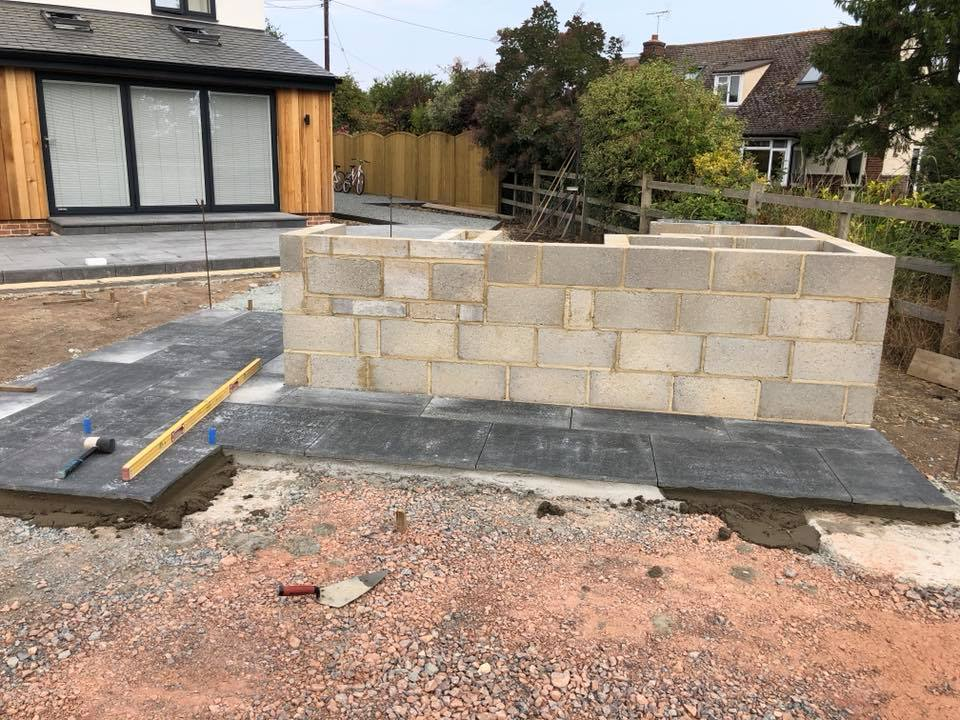 outdoor kitchen being built by professional landscapers