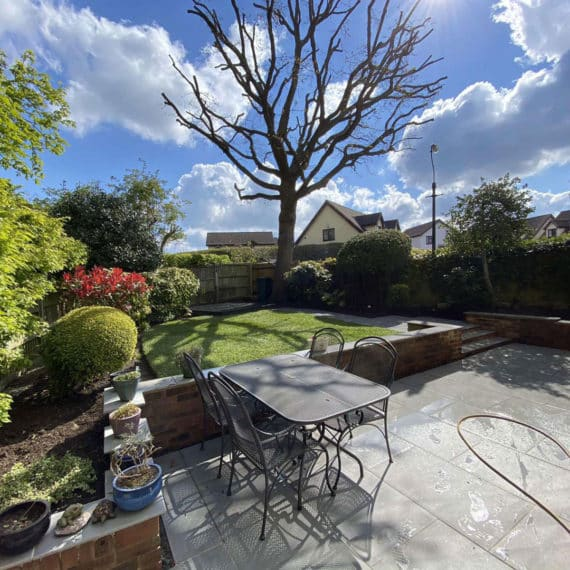 porcelain patio in florence storm paving with beautiful garden beyond