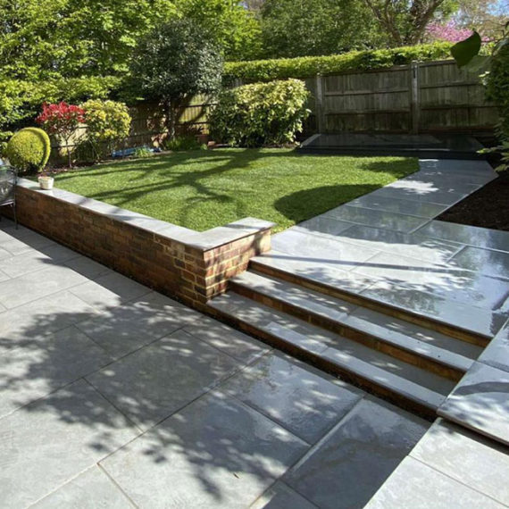porcelain patio with steps leading to path and lawn