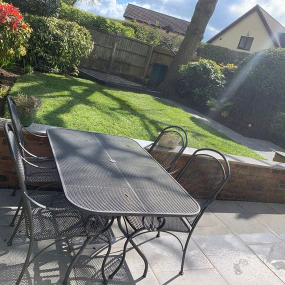 outdoor furniture on porcelain patio with lawn in the background