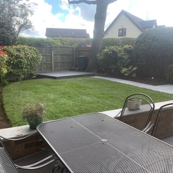 newly landscaped garden viewed from the patio with lawn and shrubbery