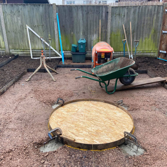 foundations for a circular feature in the centre of a lawn