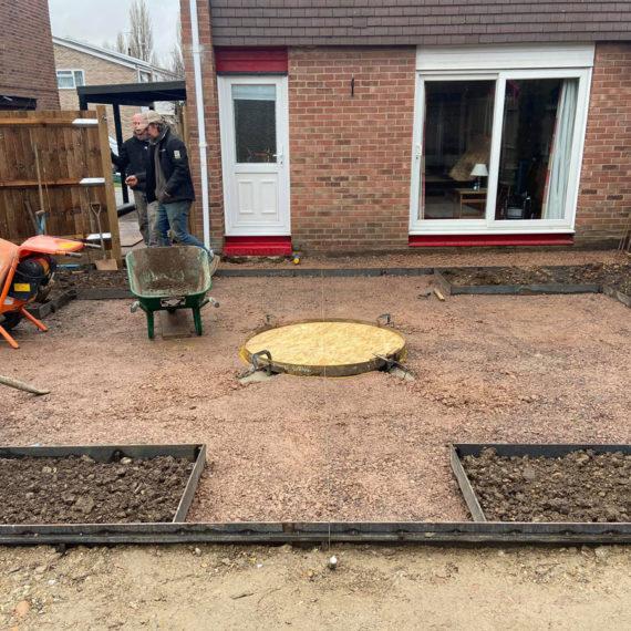 landscapers working in back garden