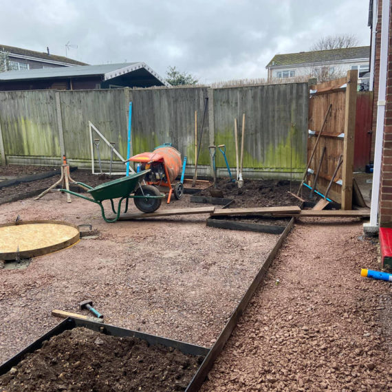 back garden being landscaped with patio and artificial grass