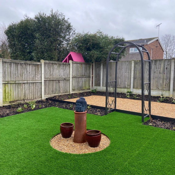 artificial lawn with circular cut out for garden ornaments