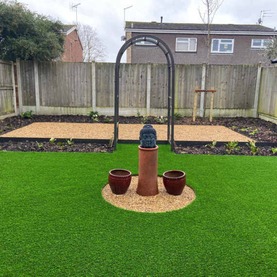 modern easy care back garden with artificial lawn